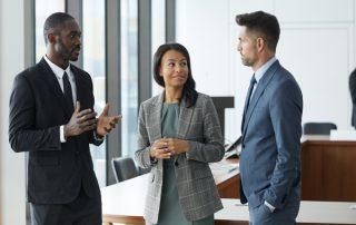 diverse business associates in conversation